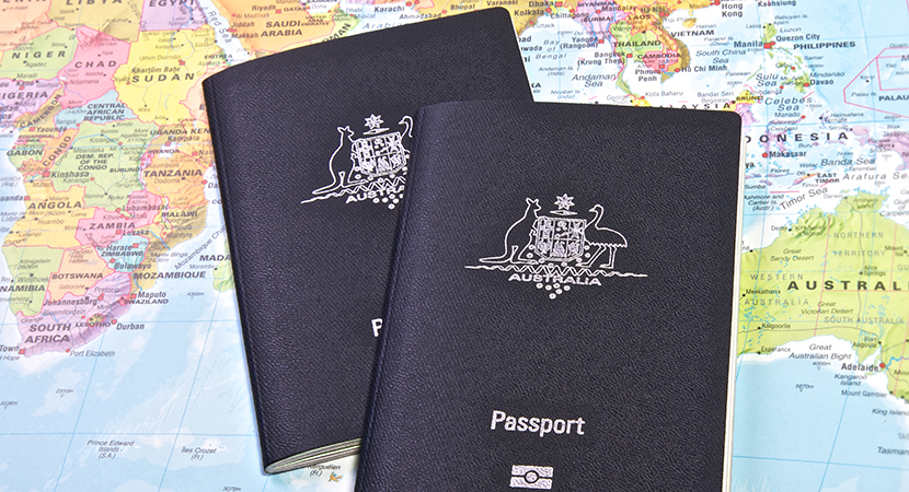Australian passport with the world map in the background